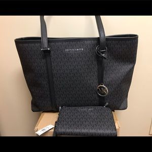 Authentic Michael Kors tote and matching wallet.